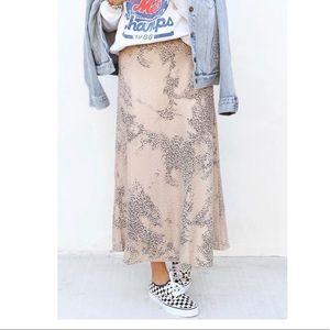 Leopard silk skirt.